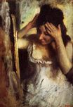 Edgar Degas - Woman Combing Her Hair in front of a Mirror 1877